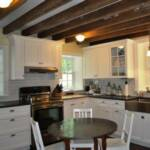 Renovated Kitchen with original beams exposed.